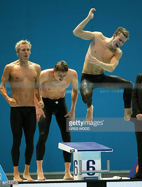 Scotland's 4 x 200m freestyle swimming team urge on their teammate during the Commonwealth Games final at the Melbourne Sports and Aquatic Center 18...