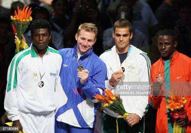 Scotland's Kenneth Anderson , with gold, Nigeria's Adura Olalehin , with silver, Australia's Benjamin McEachran and Kenya's Joshua Makonjio pose on...