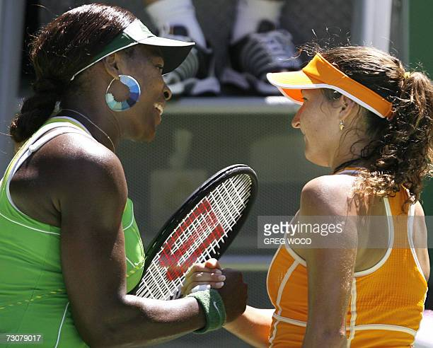 Serena Williams of the US shakes hands with Israel's Shahar Peer at the end of their women's singles quarterfinal match at the Australian Open tennis...