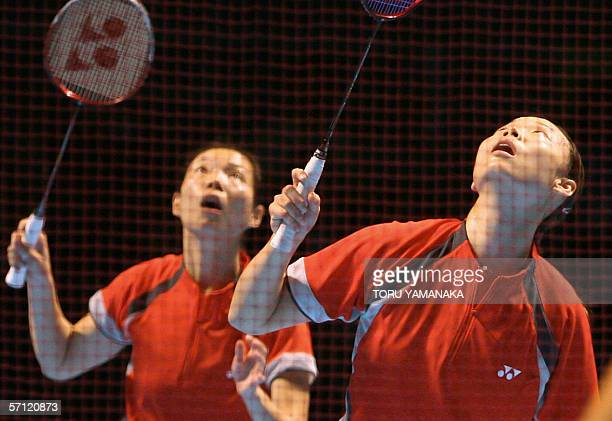 Singapore badminton players Li Yujia and Jiang Yanmei look up at the shuttlecocs for a return against Karen Foo Kune and Marlyse Marquer of Mauritius...
