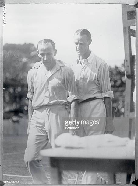 Melbourne, Australia: Tennis elimination matches in Australia for Davis Cup challengers. P. O'Hara Wood and J.O. Anderson, close ups.