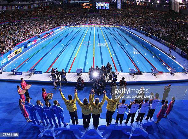 The Australian team , Japanese team and the Russian team stand on the podium during the medal ceremony for the men's 4x100m medley relay at the 12th...