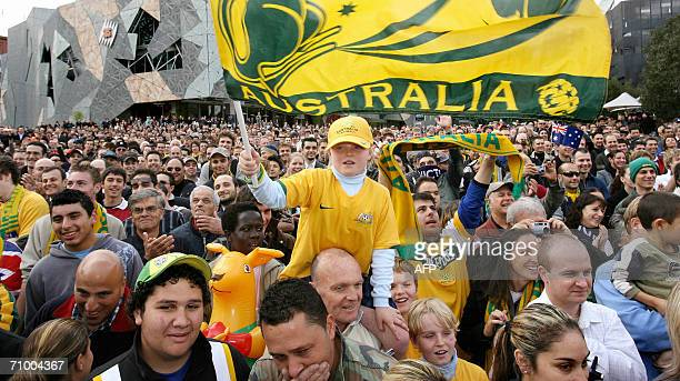 Thousands of Socceroos fans pack into Melbourne's Federation Square 22 May 2006 to meet the Australian football team as they prepare for the upcoming...