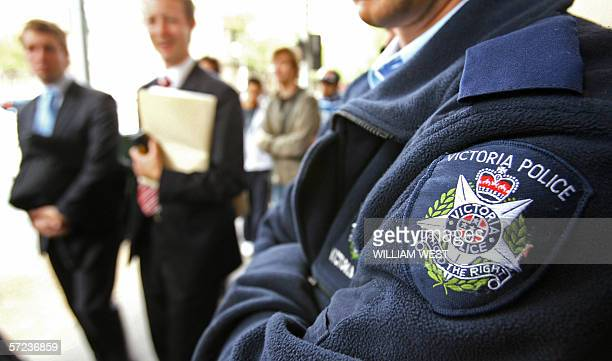 Victorian police maintain a heavy presence outside the Melbourne Magistrates Court 03 April 2006 after an Australian authorities accused a Muslim man...