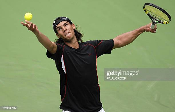 World number two Rafael Nadal of Spain eyes the ball as he serves during a practice session in the leadup to the Australian Open in Melbourne 12...