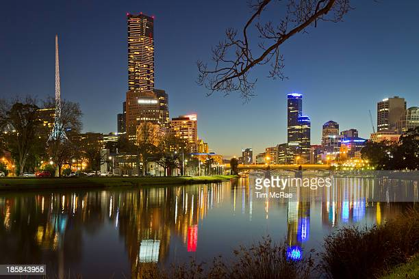CONTENT] Melbourne CBD Victoria Australia with Yarra River in Blue hour Used tree and river bank for added framing Rialto Arts Centre Spire and Edge...