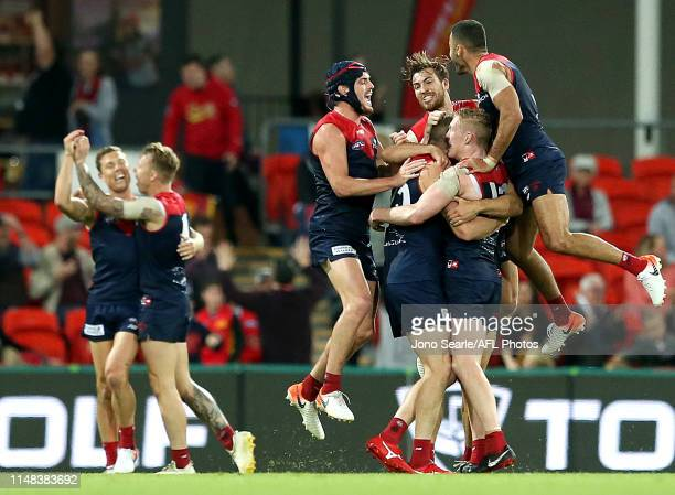 Melbourne celebrate the win during the round eight AFL match between the Gold Coast Suns and the Melbourne Demons at Metricon Stadium on May 11 2019...
