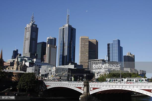 Melbourne city and moon in the blue sky