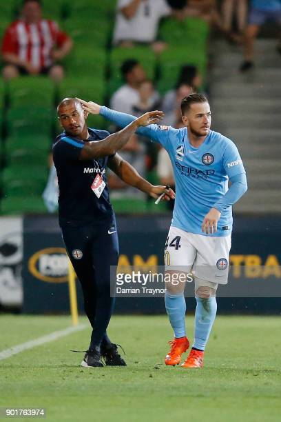 Melbourne City assistant coach Patrick Kisnorbo and Ross McCormack of emabrace after his second goal during the round 14 ALeague match between...