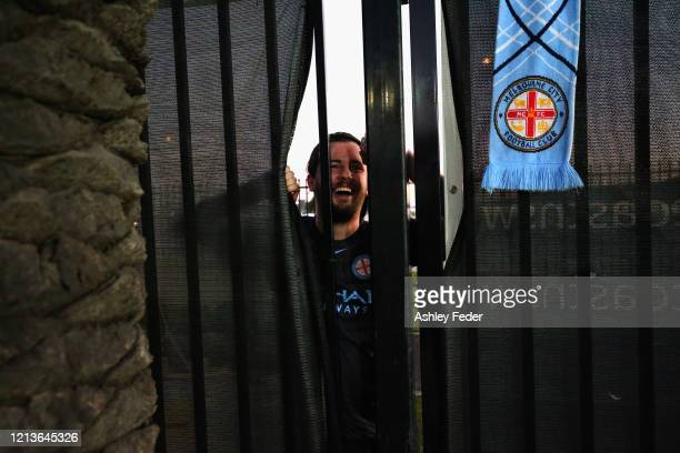 Melbourne City fan looks on from outside the stadium due to the lockout from coronavirus during the round 24 ALeague match between the Central Coast...