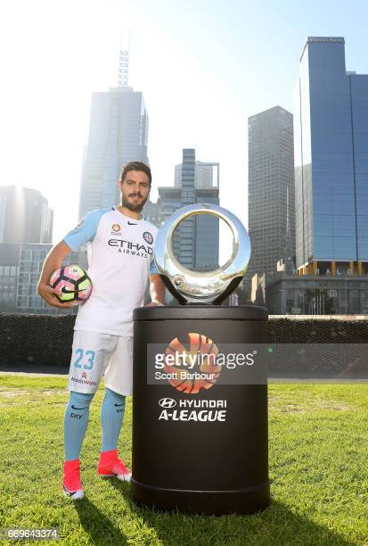 Melbourne City FC Captain Bruno Fornaroli poses with the Hyundai ALeague Championship Trophy during an ALeague Melbourne media opportunity at...
