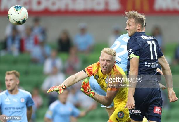 Melbourne City goalkeeper Tom Glover gets the ball away from Ola Toivonen of the Victory during the round 18 A-League match between Melbourne City...