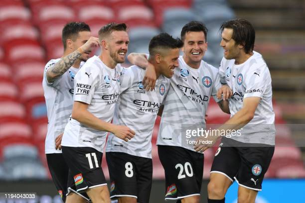 Melbourne City players celebrate a goal during the round 10 ALeague match between the Newcastle Jets and Melbourne City at McDonald Jones Stadium on...