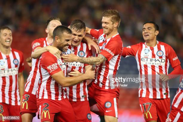 Melbourne City players celebrate a goal during the round nine ALeague match between the Newcastle Jets and Melbourne City at McDonald Jones Stadium...