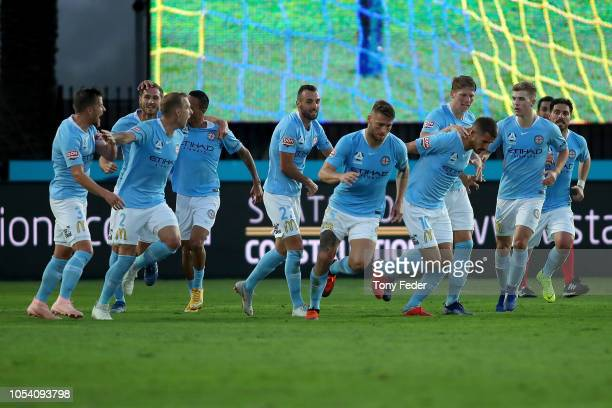 Melbourne City players celebrate a goal during the round two ALeague match between the Central Coast Mariners and Melbourne City FC at Central Coast...