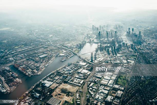 melbourne city skyline and yarra river viewed from above - docklands stadium melbourne stock pictures, royalty-free photos & images