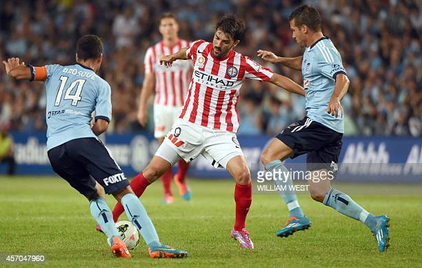 Melbourne City's Spanish player David Villa runs with the ball in his first match for the team against Sydney FC in their Australian ALeague football...