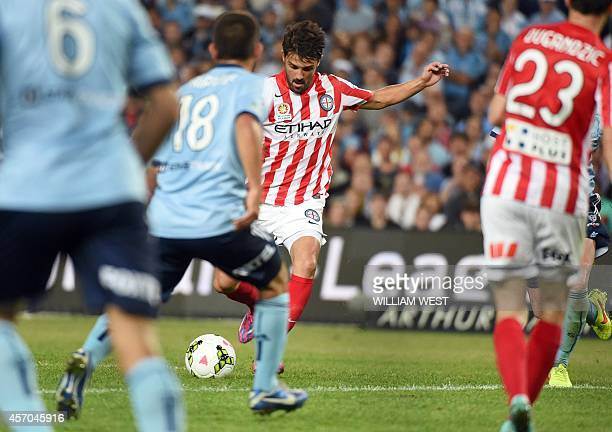 Melbourne City's Spanish player David Villa shoots and scores his first goal in his first match for the team against Sydney FC in their Australian...
