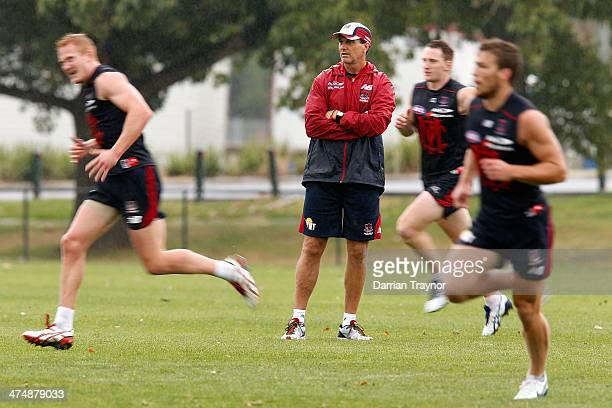 Melbourne coach Paul Roos looks on during a Melbourne Demons training session at Gosch's Paddock on February 26, 2014 in Melbourne, Australia.
