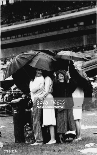 Melbourne Cup General Scenes Melbourne CupRobert Parkinson amp Alison amp Anderson and friends in the rain at Flemington November 3 1992