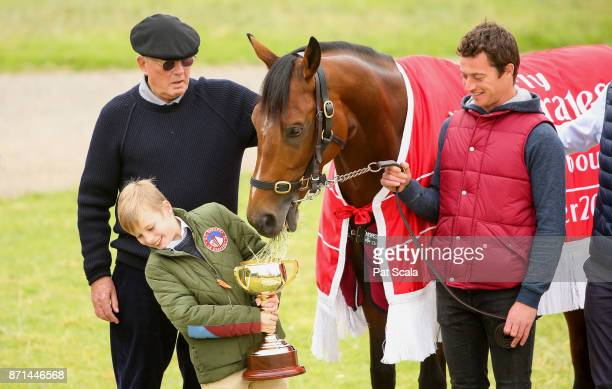 Melbourne Cup winner Rekindling is pictured with LR Lloyd Williams Lloyd's grandson Frank Williams and strapper MJ Doran at Werribee Racecourse on...