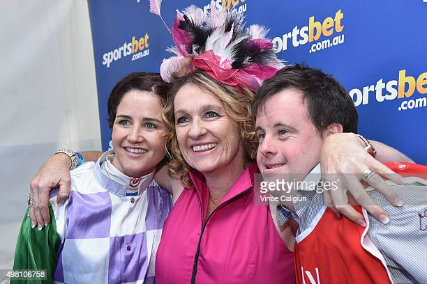 Melbourne Cup winning jockey Michelle Payne poses with racing fans and brother and strapper Stephen Payne after signing autographs during Melbourne...