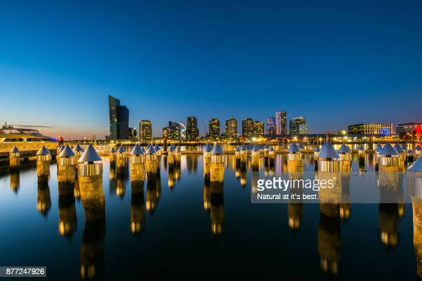 melbourne dockland (view from victoria habour promanade) - docklands stadium melbourne stock pictures, royalty-free photos & images