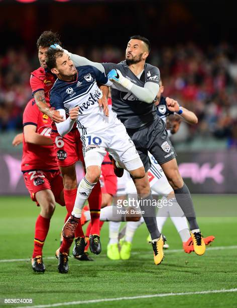 Melbourne goal keeper Lawrence Thomas over team mate James Troisi during the round three ALeague match between Adelaide United and Melbourne Victory...