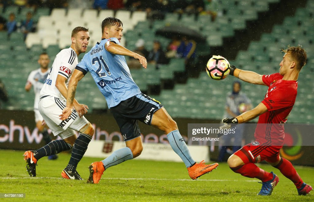 Melbourne goalkeeper Lawrence Thomas makes a save against Sydney Filip Holosko during the round 22 A-League match between Sydney FC and Melbourne Victory at Allianz Stadium on March 3, 2017 in Sydney, Australia.