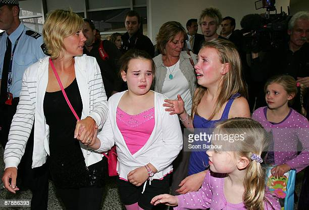 Melbourne mother Annice Smoel is embraced by her children as she arrives back home from Bangkok following overnight intervention by the Governor of...