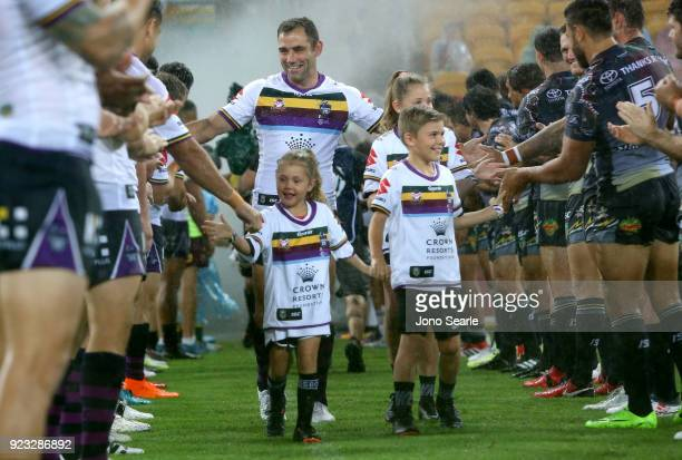 Melbourne player Cameron Smith comes out to a guard of honor with his kids before the NRL trial match and Jonathan Thurston/Cameron Smith Testimonial...