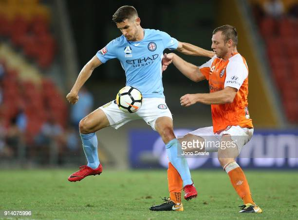 Melbourne player Dario Vidosic and Avram Papadopoulos compete for the ball during the round 19 ALeague match between the Brisbane Roar and Melbourne...