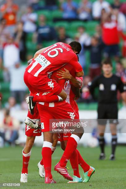 Melbourne players celebrate a Orlando Engelaar goal during the round 20 ALeague match between Melbourne Heart and Brisbane Roar at AAMI Park on...