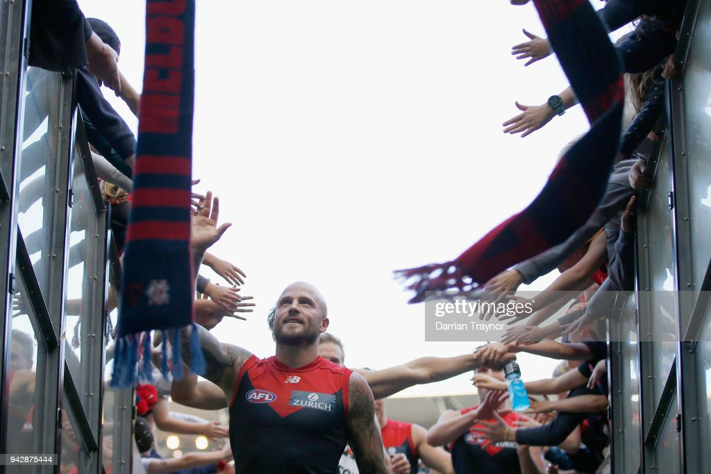 Melbourne players ealk off the ground after the round three AFL match between the Melbourne Demons and the North Melbourne Kangaroos at Melbourne Cricket Ground on April 7, 2018 in Melbourne, Australia.