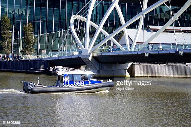 Melbourne Police boat patrolling the Yarra river as officers block areas around Flinders Street and Melbourne Docklands as suspicious package...