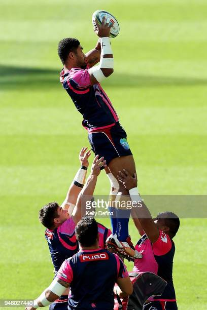 Melbourne Rebels team warm up prior to the round nine Super Rugby match between the Rebels and the Jaguares at AAMI Park on April 14 2018 in...