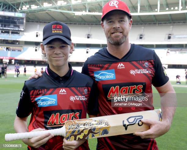 Melbourne Renegades Captain Dan Christian poses with a photo with the designer of his bat during the Big Bash League match between the Melbourne...