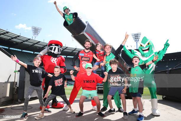 Melbourne Renegades player Kane Richardson and Melbourne Stars player Adam Zampa pose with YMCA and School Of Rock kids in front of the giant Human...