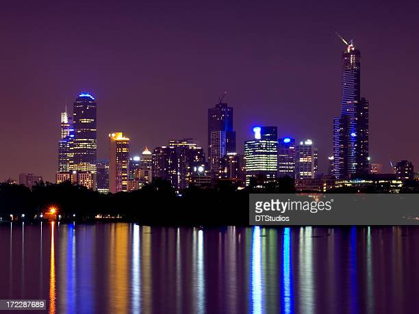 Melbourne skyline reflected on the sea at night