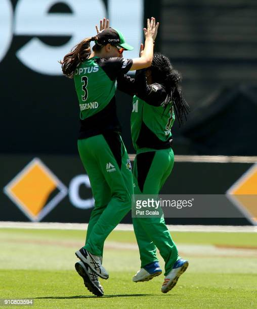 Melbourne Stars Annabel Sutherland and Alana King celebrate the wicket of Hayley Matthews during the Women's Big Bash League match between the...