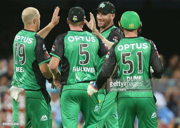 Melbourne Stars player John Hastings celebrates taking a catch with team mates during the Big Bash League match between the Brisbane Heat and the...