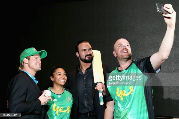 Melbourne Stars players Alana King and Michael Beer pose for photos with Dolph Ziggler and Drew McIntyre during a WWE Downunder media opportunity at...