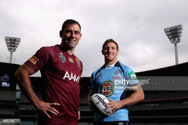 Melbourne Storm captain Cameron Smith along with teammate Ryan Hoffman pose for photos during a NRL and Victoria Government announcement at Melbourne...