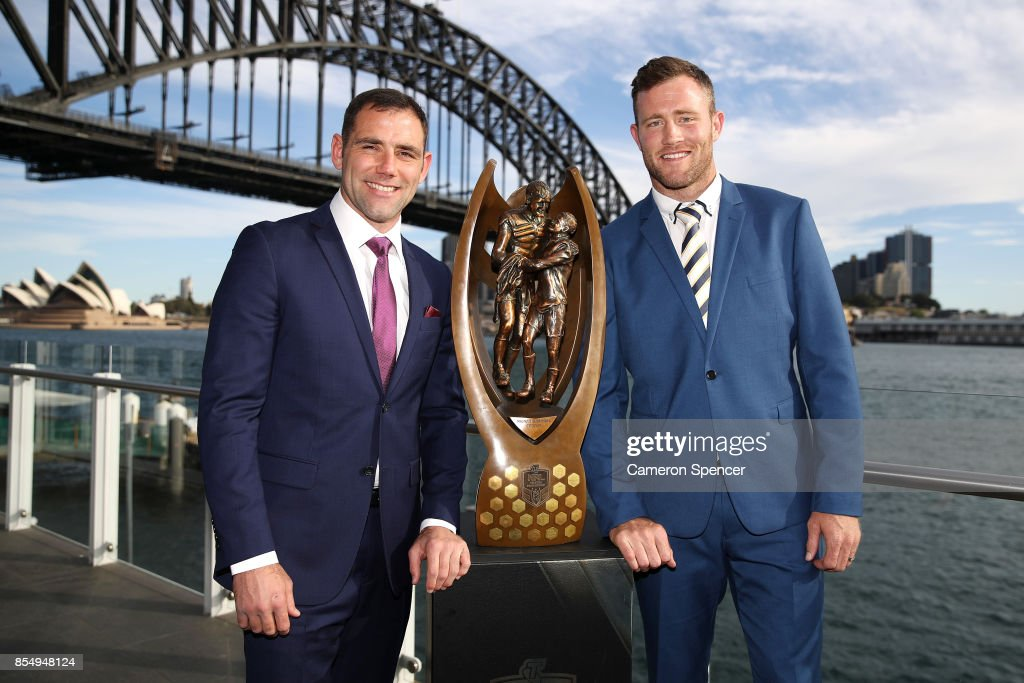 Melbourne Storm captain Cameron Smith and North Queensland Cowboys captain Gavin Cooper pose with the Provan Summons trophy during the NRL Grand Final press conference at Luna Park on September 28, 2017 in Sydney, Australia.