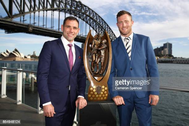 Melbourne Storm captain Cameron Smith and North Queensland Cowboys captain Gavin Cooper pose with the Provan Summons trophy during the NRL Grand...