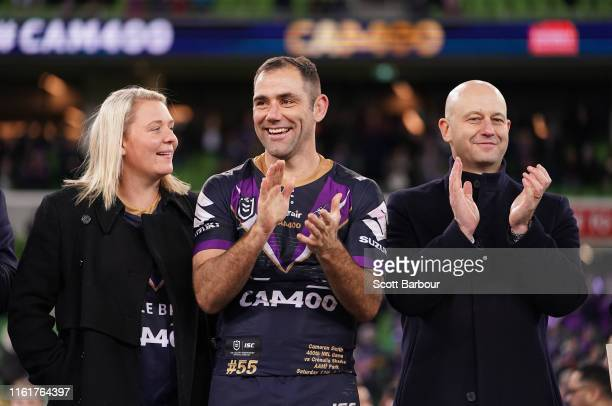 Melbourne Storm Captain Cameron Smith gestures to the crowd as his wife Barbara Smith and Todd Greenberg, the Chief Executive Officer of the National...