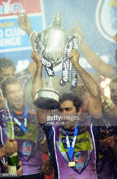 Melbourne Storm captain Cooper Cronk celebrates beating Leeds Rhinos in the Rugby League World Club Challenge at Elland Road in Leeds northern...