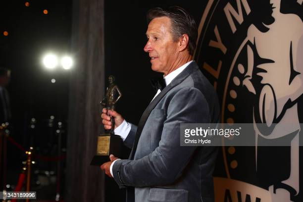 Melbourne Storm coach Craig Bellamy poses after winning Coach of the Year during the NRL 2021 Dally M Awards at the Howard Smith Wharves on September...