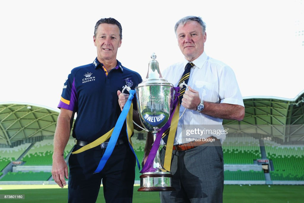 Melbourne Storm Head Coach Craig Bellamy (L) and Leeds Rhino's CEO Gary Hetherington pose with the World Club Challenge Trophy during a Melbourne Storm NRL media announcement at AAMI Park on November 14, 2017 in Melbourne, Australia. NRL Premiers Melbourne Storm will host English Super League Premiers Leeds Rhinos in the World Club Challenge to determine the world's best rugby league team.