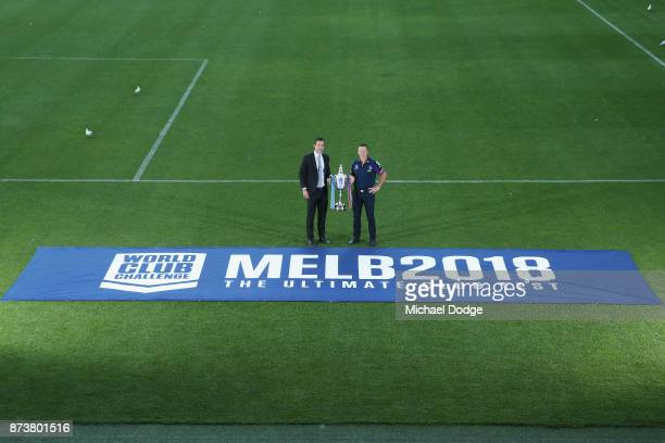 Melbourne Storm Head Coach Craig Bellamy and Storm CEO Dave Donaghy pose with the World Club Challenge Trophy during a Melbourne Storm NRL media...